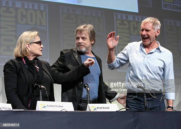Actors Carrie Fisher Mark Hamill and Harrison Ford at the Hall H Panel for Star Wars The Force Awakens during ComicCon International 2015 at the San...