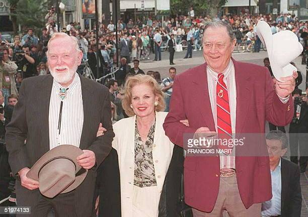 Actors Carroll Baker Ben Johnson and Harry Carey Jr pose for photographers 20 May on the steps of the Cannes' Palais des Festival at the...