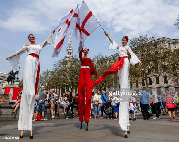 Actors carry English flags as Londoners celebrate the annual Feast of St George the patron of England in Trafalgar Square London England on April 21...
