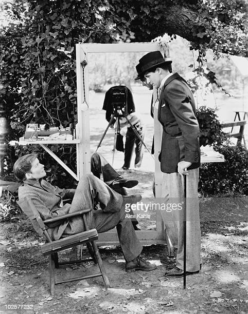 Actors Cary Grant and Katharine Hepburn on the set of 'Sylvia Scarlett' directed by George Cukor California 1935 Photographer Alex Kahle can be seen...