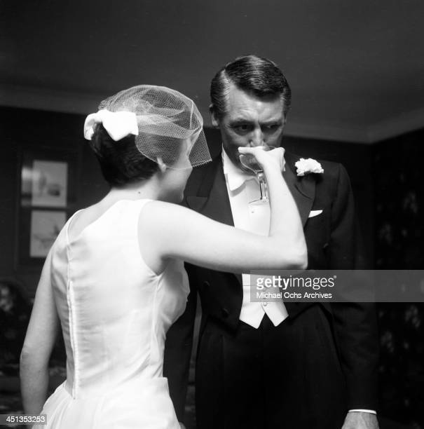 Actors Cary Grant with Barbara Rodney attend the Carol Ladd Dick Anderson wedding in Los Angeles California