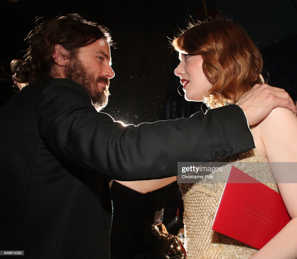 Actors Casey Affleck and Emma Stone greet backstage during the 89th Annual Academy Awards at Hollywood & Highland Center on February 26, 2017 in Hollywood, California.