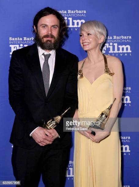Actors Casey Affleck and Michelle Williams pose backstage with the Cinema Vanguard Award during the 32nd Santa Barbara International Film Festival at...