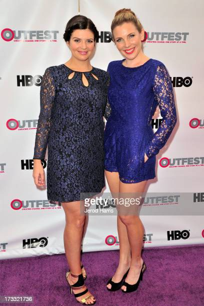 Actors Casey Wilson and June Raphael arrive at the Outfest Opening Night Gala of COG at Orpheum Theatre on July 11 2013 in Los Angeles California