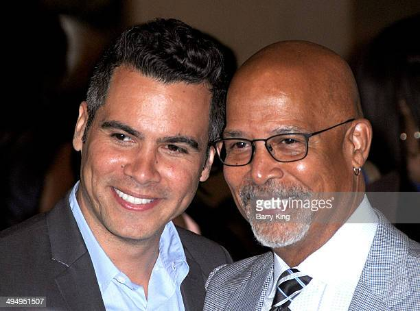 Actors Cash Warren and Michael Warren arrive at The Helping Hand Of Los Angeles Mother's Day Luncheon on May 9 2014 at The Beverly Hilton Hotel in...