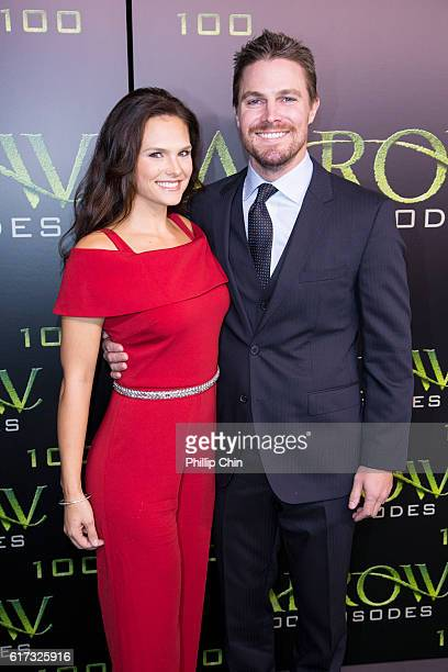 Actors Cassandra Jean and Stephen Amell arrive on the green carpet for the Celebration of the 100th Episode of CW's Arrow at the Fairmont Pacific Rim...