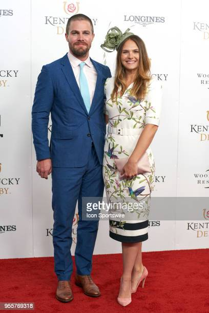 Actors Cassandra Jean and Stephen Amell attend Kentucky Derby 144 on May 5, 2018 in Louisville, Kentucky..
