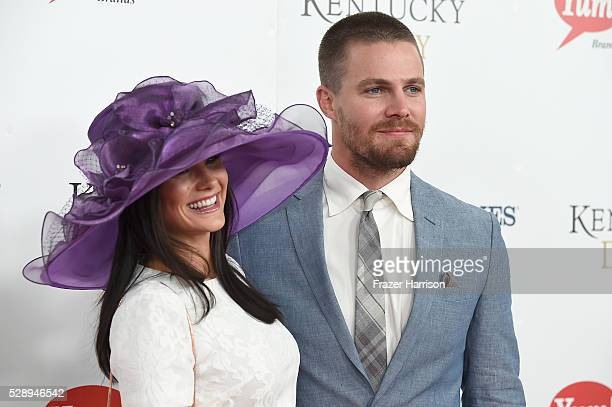 Actors Cassandra Jean and Stephen Amell attend the 142nd Kentucky Derby at Churchill Downs on May 07, 2016 in Louisville, Kentucky.