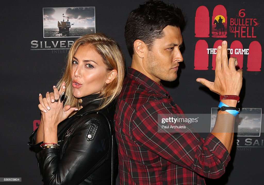 Actors Cassie Scerbo (L) and Redford (R) attends the launch of '6 Bullets To Hell' the video game and the movie on May 10, 2016 in Los Angeles, California.