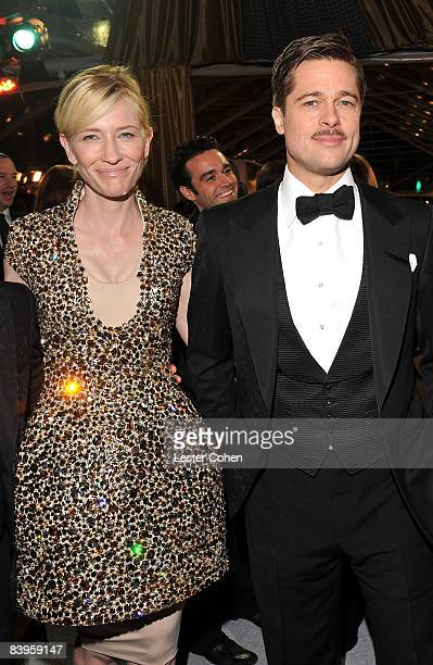 Actors Cate Blanchett and Brad Pitt arrive on the red carpet for the Los Angeles premiere of The Curious Case Of Benjamin Button at the Mann's...