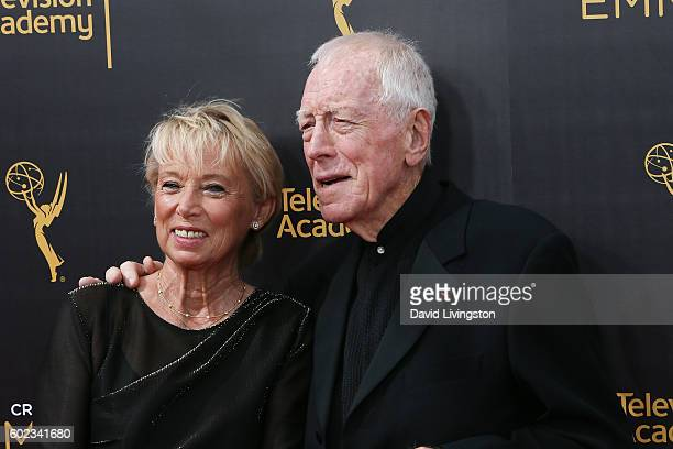 Actors Catherine Brelet and Max von Sydow attend the 2016 Creative Arts Emmy Awards Day 1 at the Microsoft Theater on September 10 2016 in Los...