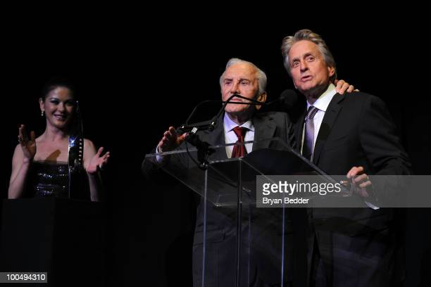 Actors Catherine Zeta Jones and Kirk Douglas present Michael Douglas with a award at the The Film Society of Lincoln Center's 37th Annual Chaplin...