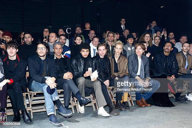 Actors Cesar Domboy Felix de Givry Sami Bouajila Guest Lucas Ionesco Aymeline Valade Nicolas Godin and Haider Ackermann attend the Lanvin Menswear...