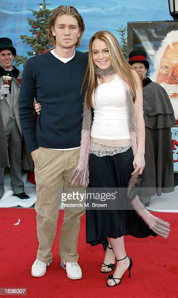 Actors Chad Michael Murray and Lindsay Lohan attend the film premiere of The Santa Claus 2 at the El Capitan Theatre on October 27 2002 in Hollywood...