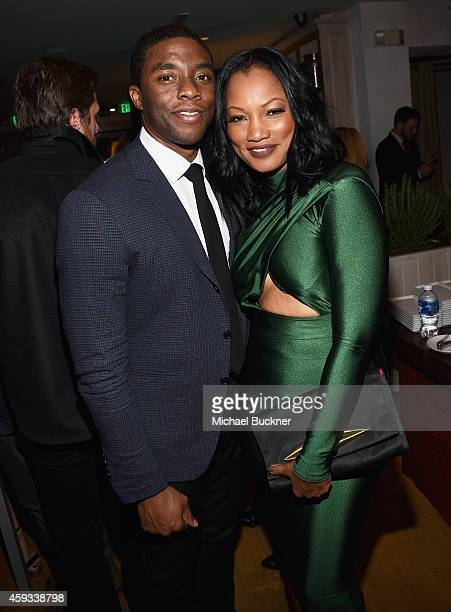 Actors Chadwick Boseman and Garcelle Beauvais attend the HFPA and InStyle Celebrate The 2015 Golden Globe Award Season and Miss Golden Globe at Fig...