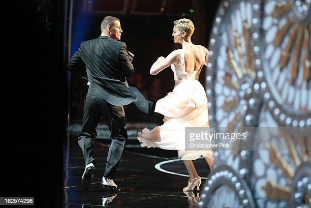 Actors Channing Tatum and Charlize Theron dance onstage seen from backstage during the Oscars held at the Dolby Theatre on February 24 2013 in...