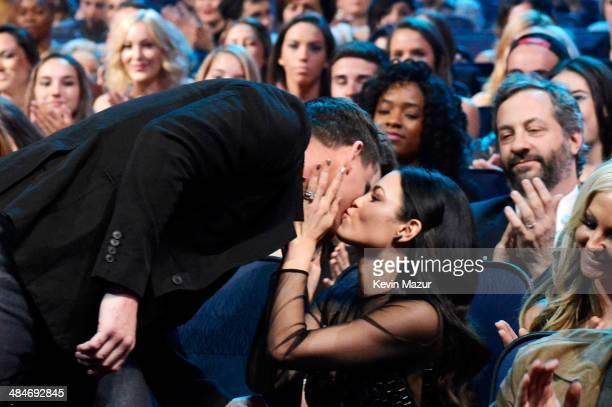 Actors Channing Tatum and Jenna Dewan Tatum attend the 2014 MTV Movie Awards at Nokia Theatre LA Live on April 13 2014 in Los Angeles California