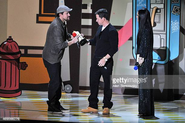 Actors Channing Tatum Mark Wahlberg and singer Jessie J speak onstage during The 2015 MTV Movie Awards at Nokia Theatre LA Live on April 12 2015 in...