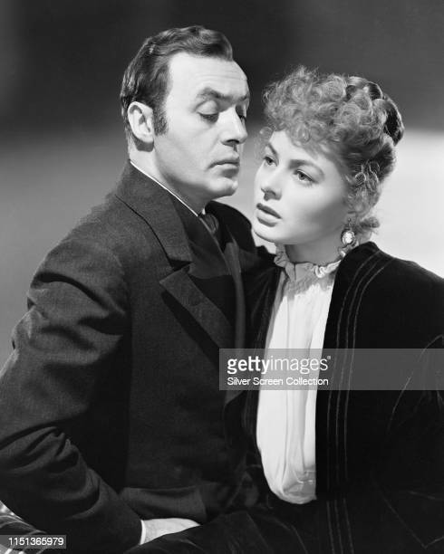 Actors Charles Boyer as Gregory Anton and Ingrid Bergman as Paula Alquist in a promotional shot for the film 'Gaslight' 1944