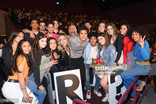 Actors Charles Melton and Yara Shahidi pose with fans at the ultimate 'Promposal' at a Toronto screening of 'The Sun Is Also a Star' at Cineplex...