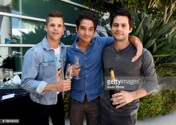 Actors Charlie Carver Tyler Posey and Dylan O'Brien from 'Teen Wolf' celebrate their final season backstage after their Hall H panel during ComicCon...