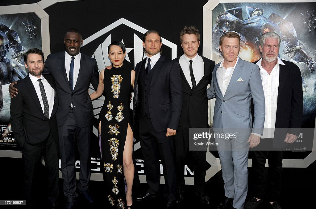 Actors Charlie Day, Idris Elba, Rinko Kikuchi, Charlie Hunnam, Robert Kazinsky, Diego Klattenhoff and Ron Perlman arrive at the premiere of Warner Bros. Pictures' and Legendary Pictures' 'Pacific Rim' at Dolby Theatre on July 9, 2013 in Hollywood, California.