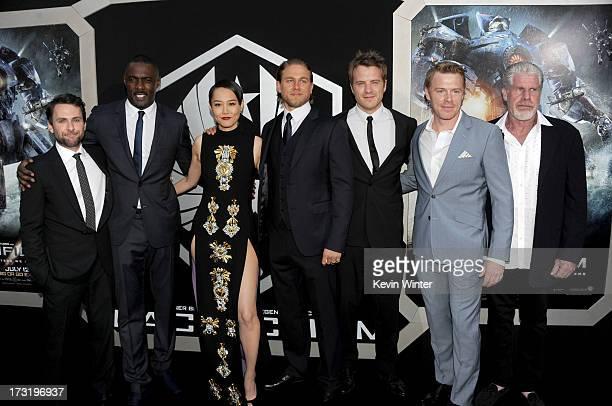 Actors Charlie Day, Idris Elba, Rinko Kikuchi, Charlie Hunnam, Robert Kazinsky, Diego Klattenhoff and Ron Perlman arrive at the premiere of Warner...
