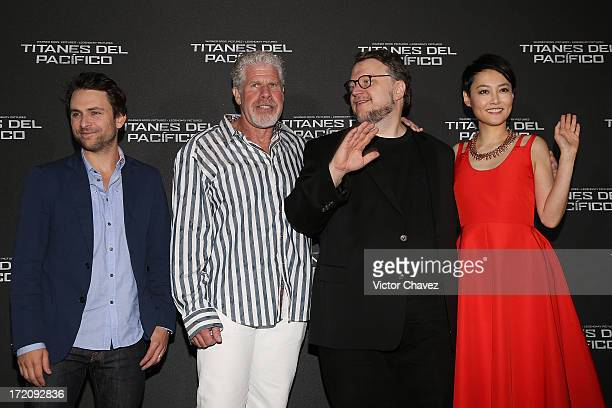 """Actors Charlie Day, Ron Perlman, film director Guillermo Del Toro and actress Rinko Kikuchi attend a photocall to promote the film """"Pacific Rim """" at..."""