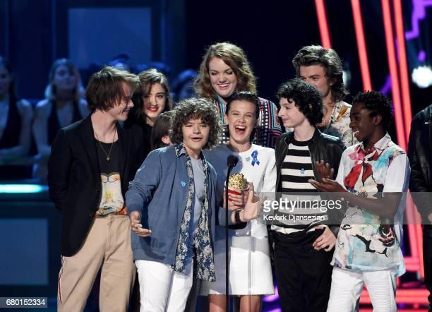 Actors Charlie Heaton Natalia Dyer Gaten Matarazzo Shannon Purser Millie Bobby Brown Finn Wolfhard Joe Keery and Caleb McLaughlin accept the award...