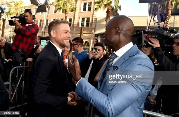 Actors Charlie Hunnam and Djimon Hounsou attend the premiere of Warner Bros Pictures' 'King Arthur Legend Of The Sword' at TCL Chinese Theatre on May...