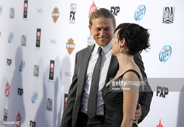 Actors Charlie Hunnam and Maggie Siff attend the season 6 premiere of FX's Sons Of Anarchy at Dolby Theatre on September 7 2013 in Hollywood...