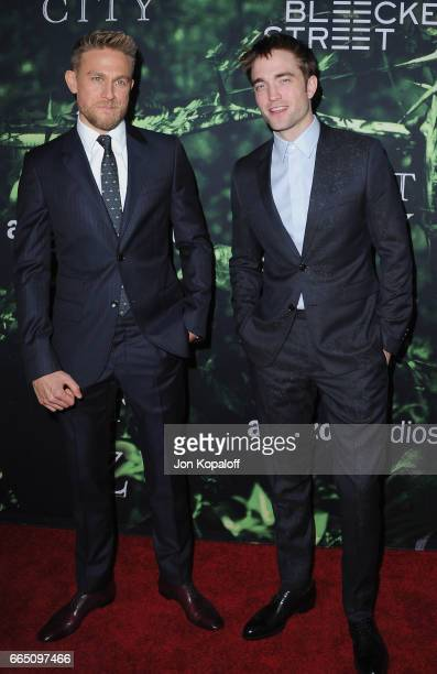 Actors Charlie Hunnam and Robert Pattinson arrive at the Premiere Of Amazon Studios' 'The Lost City Of Z' at ArcLight Hollywood on April 5 2017 in...