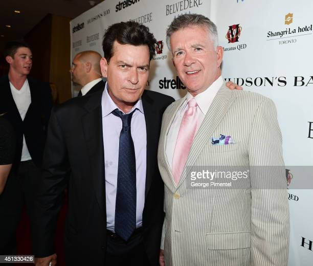 Actors Charlie Sheen and Alan Thicke attend the Joe Carter Classic Charity Golf Tournament afterparty at ShangriLa Hotel on June 26 2014 in Toronto...