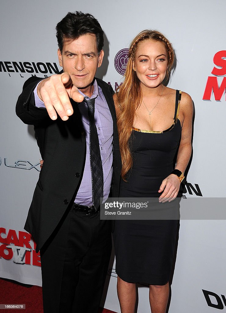 Actors Charlie Sheen (L) and Lindsay Lohan arrive at the 'Scary Movie V' Los Angeles premiere at ArcLight Cinemas Cinerama Dome on April 11, 2013 in Hollywood, California.