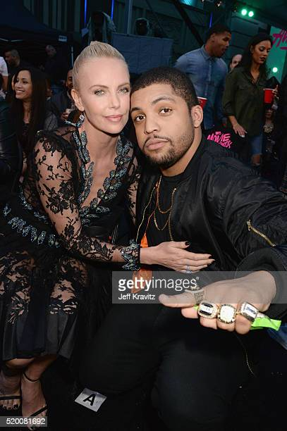 Actors Charlize Theron and O'Shea Jackson Jr attend the 2016 MTV Movie Awards at Warner Bros Studios on April 9 2016 in Burbank California MTV Movie...