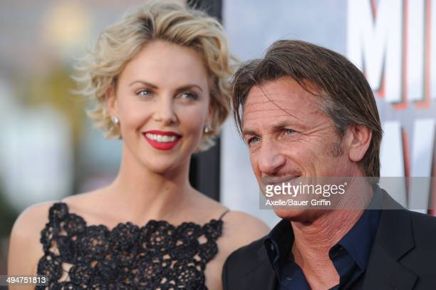 Actors Charlize Theron and Sean Penn arrive at the Los Angeles premiere of 'A Million Ways To Die In The West' at Regency Village Theatre on May 15,...