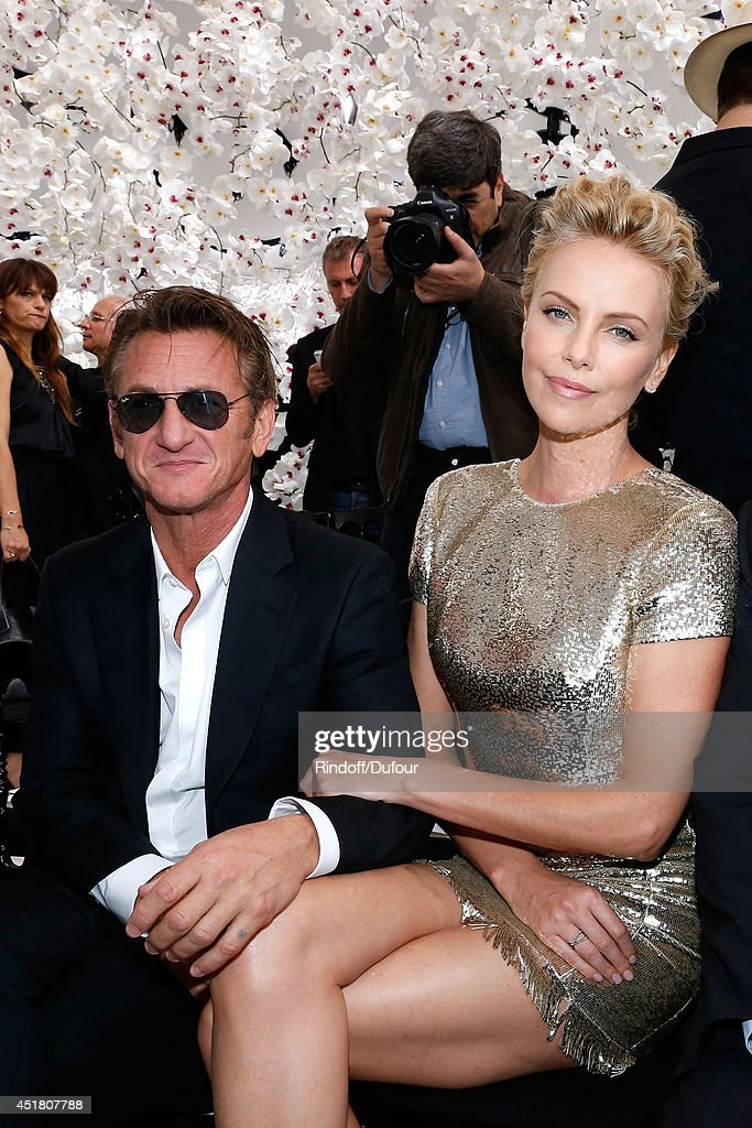 Actors Charlize Theron and Sean Penn attend the Christian Dior show as part of Paris Fashion Week - Haute Couture Fall/Winter 2014-2015. Held at Musee Rodin on July 7, 2014 in Paris, France.
