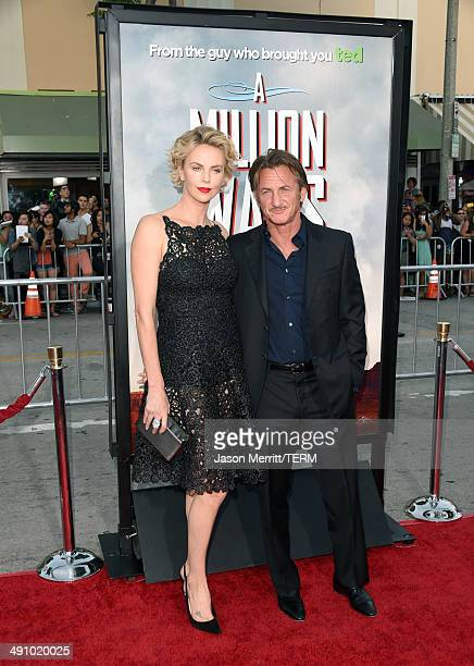 Actors Charlize Theron and Sean Penn attend the premiere of Universal Pictures and MRC's A Million Ways To Die In The West at Regency Village Theatre...