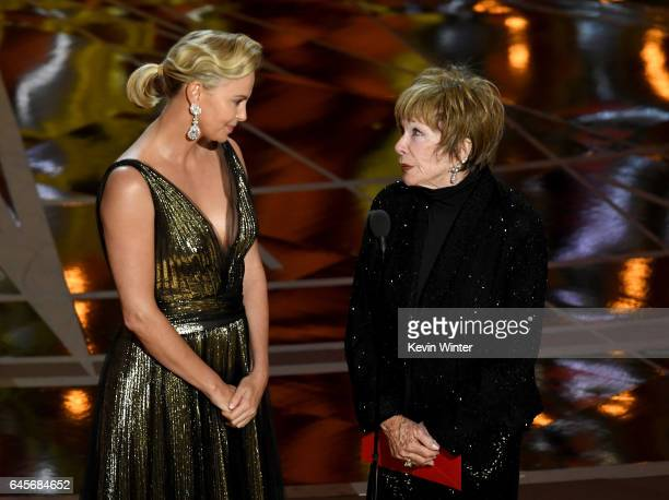 Actors Charlize Theron and Shirley MacLaine speak onstage during the 89th Annual Academy Awards at Hollywood Highland Center on February 26 2017 in...