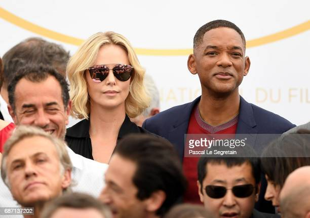 Actors Charlize Theron and Will Smith attend the 70th Anniversary Photocall during the 70th annual Cannes Film Festival at Palais des Festivals on...