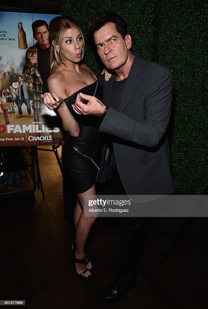 Actors Charlotte McKinney and Charlie Sheen attend the premiere party for Crackle's 'Mad Families' at Catch on January 9, 2017 in West Hollywood, California.