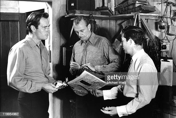 Actors Charlton Heston and Gary Cooper on the set of the film 'The Wreck of the Mary Deare' with director Michael Anderson MGM Studios Boreham Wood...