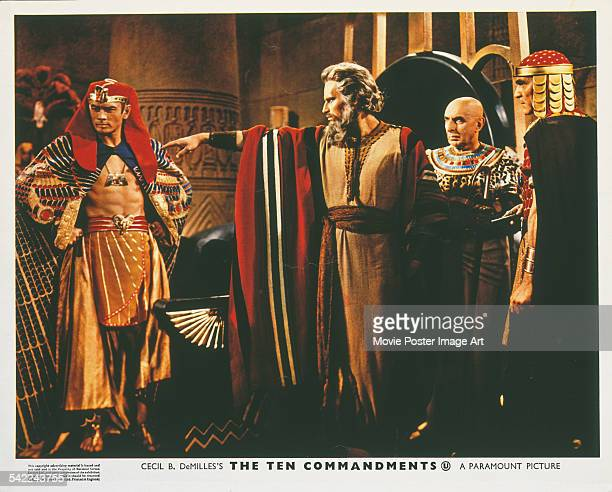 Actors Charlton Heston and Yul Brynner appear on the poster for the Paramount Pictures film 'The Ten Commandments', 1956. The film was directed by...