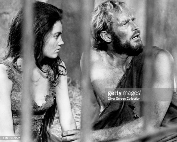 Actors Charlton Heston as George Taylor and Linda Harrison as Nova in the film 'Planet of the Apes' 1968