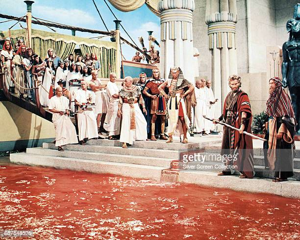 Actors Charlton Heston as Moses and Yul Brynner as Pharaoh Rameses II of Egypt in the biblical epic 'The Ten Commandments' 1956 Here Moses turns the...