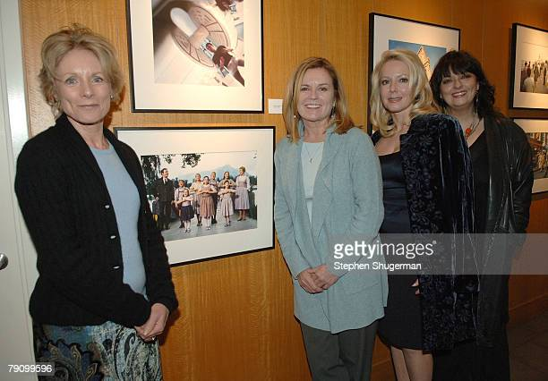 Actors Charmian Carr Heather Menzies Kym Kareth and Angela Cartwright pose in front of a picture of them from the Sound of Music taken by Douglas...