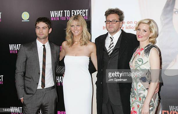 Actors Chase Crawford Brooklyn Decker director Kirk Jones and Elizabeth Banks attend the What To Expect When Your Expecting premiere at AMC Lincoln...