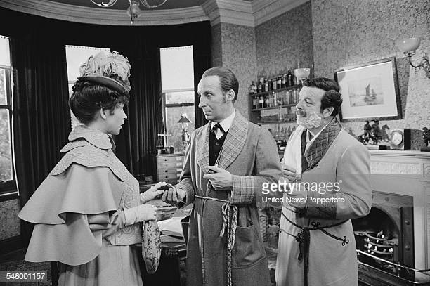 Actors Cherie Lunghi Ian Richardson and David Healy pictured together dressed in character as Mary Morstan Sherlock Holmes and Doctor Watson during...