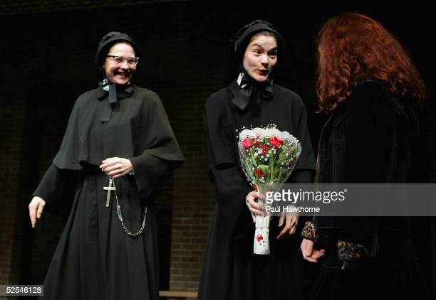 Actors Cherry Jones and Heather Goldenhersh greet a young fan with flowers during the curtain call of 'Doubt' at the Walter Kerr Theater on March 31...