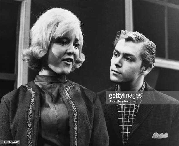 Actors Cheryl Kennedy as Marilyn Bishop and Barry Bethel as her boyfriend Alf Hitchens in the play 'What A Crazy World' at the Theatre Royal in...